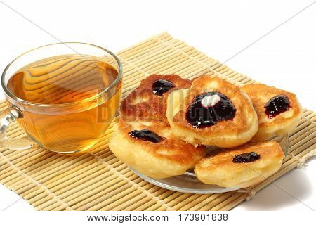 fritters with jam with tea on wood