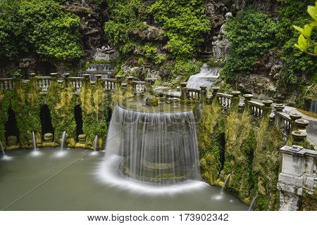 waterfall and garden of the villa of cardinal Ippolito d`Este Tivoli Italy.