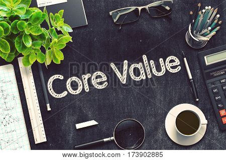 Core Value - Black Chalkboard with Hand Drawn Text and Stationery. Top View. 3d Rendering. Toned Illustration.