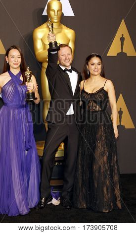 Salma Hayek, Joanna Natasegara and Orlando von Einsiede at the 89th Annual Academy Awards - Press Room held at the Hollywood and Highland Center in Hollywood, USA on February 26, 2017.
