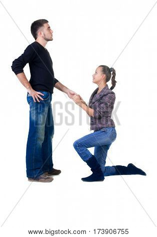 young woman makes a declaration of love to the man. Isolated over white.