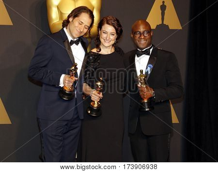 Jeremy Kleiner, Adele Romanski and Barry Jenkins at the 89th Annual Academy Awards - Press Room held at the Hollywood and Highland Center in Hollywood, USA on February 26, 2017.