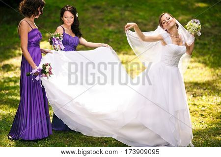 Bride Feels Like A Bird Standing With Bridesmaids In The Park