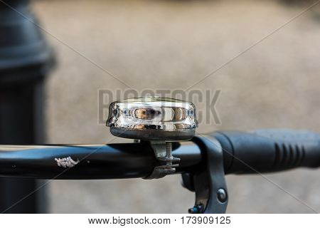 Chrome bell on an old bycicle - close up