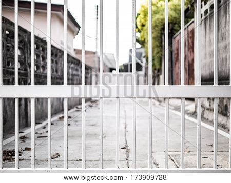 White Wrought Fence To Property , Road  Line, Outside