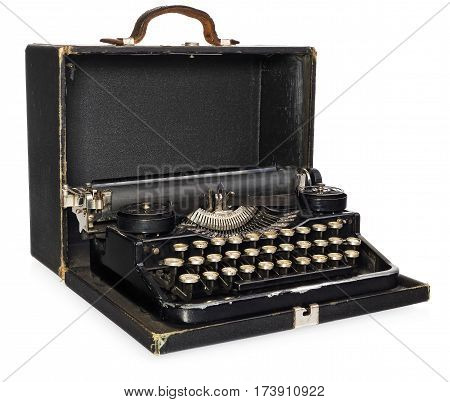 Old antique vintage portable typewriter in an open leather case. Antique typewriter in black with white keys of the Polish alphabet. The device isolated on a white background with light shadow and reflection.