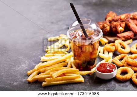Fast Food Meals : Onion Rings, French Fries, Glass Of Cola And Fried Chicken