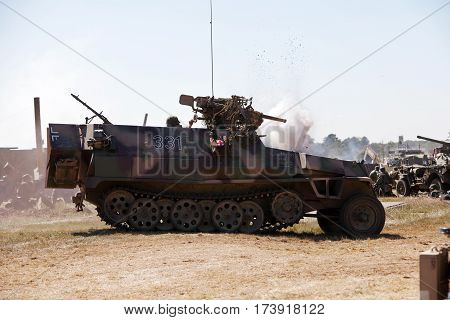 WESTERNHANGER, UK - JULY 19: A German WW2 halftrack enters the battle re-enactment for the public to watch at the War & Peace show on July 19, 2013 in Westernhanger
