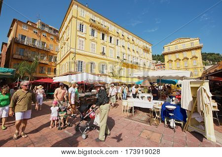 NICE, FRANCE - JULY 27, 2009: Unidentified people visit street market in Nice, France.