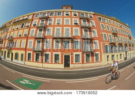 NICE, FRANCE - JULY 27, 2009: Unidentified man rides bicycle in Nice, France. Filmed with a wide angle lens.