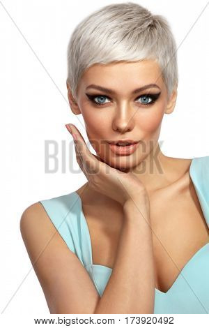 Young beautiful tanned woman with stylish cat eye make-up and platinum blonde hair touching her face over white background, copy space poster