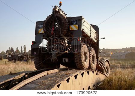 WESTERNHANGER, UK - JULY 19: A privately owned Scammel Explorer recovery truck crosses a Bailey bridge at the War & Peace revival show on July 19, 2013 in Westernhanger