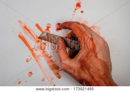 Bloody Hand Holds A Razor