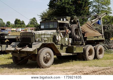WESTERNHANGER, UK - JULY 18: A vintage US army recovery vehicle stands in one of the outer public viewing fields at the War & Peace show on July 18, 2013 in Westernhanger