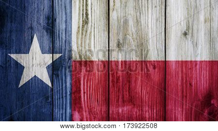 Texas flag on wood texture background. Abstract Flag background.