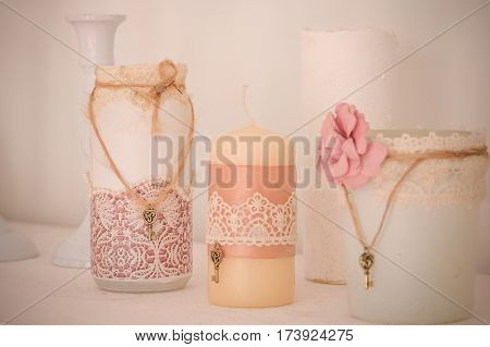 Wedding decor. wedding interior. festive decor. Pastel decor. candles looks like vintage style. Candles close up. The vague image. vintage candels, weeding decoration