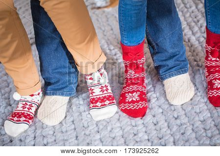 Close-up partial view of female feet in knitted socks