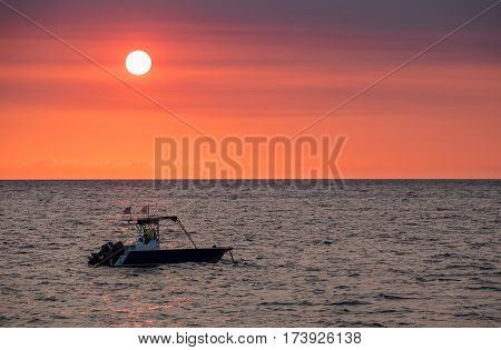 Sunset Over Madagascar Nosy Be Beach With Boat Silhouette