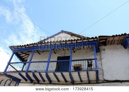 Blue wooden balcony of an old colonial house in Cuzco, Peru.
