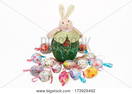 Toy Easter bunny and decoupage Easter eggs isolated on white
