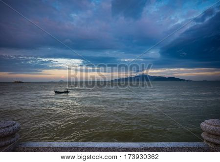 A colourful cloudy evening sky over the south china sea and coastal islands in Nha Trang Vietnam.