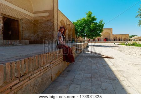 Tourist in ancient city - Bukhara, Uzbekistan, summer time