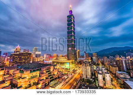 TAIPEI, TAIWAN - FEBRUARY 26, 2017: Taipei 101 towers over the Xinyi District at twilight. The skyscraper was briefly the world's tallest from 2004-2009.