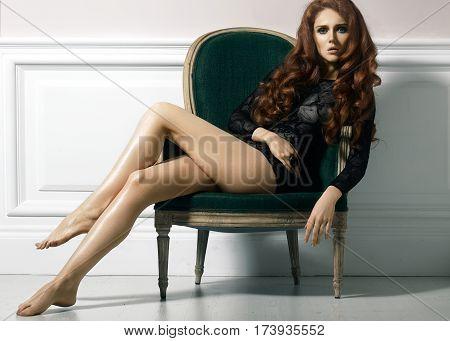 Beautiful Luxury Woman Model Posing In Black Lacy Dress In Rertro Chair. Beautiful Portrait In Inter