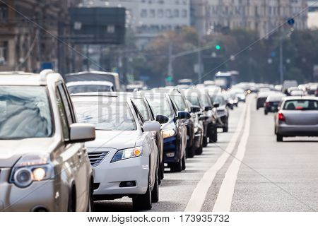 Closeup congested lane with queue of cars