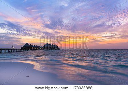 Fantastic colorful sunset on a tropical island in the Maldives. Luxury Resort Angaga. Ari Atoll.