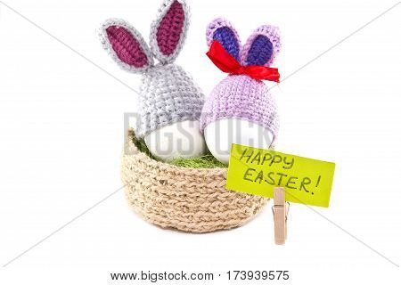 Easter Eggs In The Nest. Knitted Easter Bunny. Egg In Easter Bunny Cap. White Background. Isolated.
