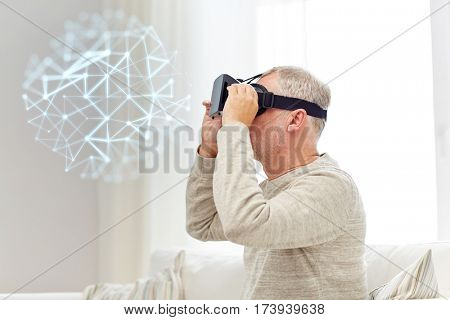 technology, augmented reality, gaming, entertainment and people concept - senior man in virtual headset or 3d glasses with low poly projection at home