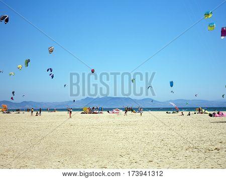 Kitesurfers on the beautiful beach of Tarifa. Spain