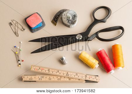 Basic Sewing Equipment On An Off-white Background