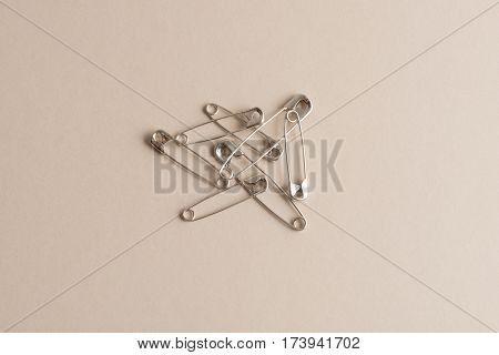 Safety Pins On A White Background