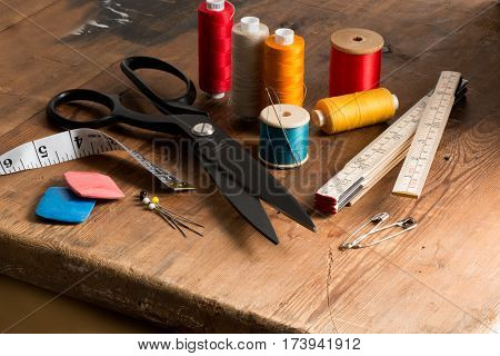 Sewing Tools And Spools Of Different Color Thread