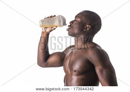 Male black bodybuilder wearing white tanktop on ripped muscular torso in studio shot on black background
