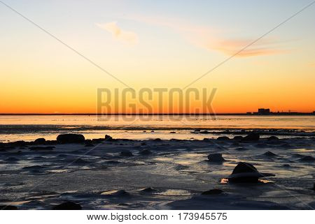 Beautiful winter sunset by the coast of the Baltic Sea