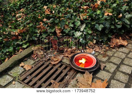 Beautiful red candle burning on a granite cubes