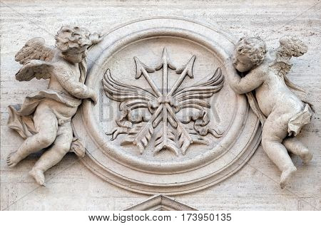 ROME, ITALY - SEPTEMBER 01: Angels with symbols of martyrdom on the portal of Sant Andrea della Valle Church in Rome, Italy on September 01, 2016.