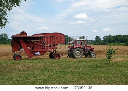 TRNOVEC, CROATIA - JULY 09, 2016: Old Threshing Machine in Trnovec, Croatia on July 09, 2016.