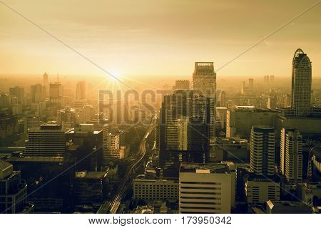 City skyline with urban skyscrapers at sunset. City during warm sunset concept