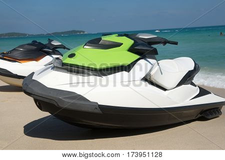 Jetski are on the sand ready for a ride on the sea
