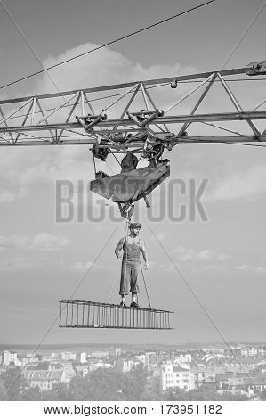 Developing city. Vertical monochrome shot of a retro builder at construction site professionalism vintage work worker engineering developer masculinity muscular athletic strength confidence concept