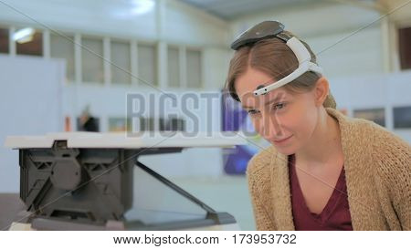 Concentrated woman playing mind control game. Future and technology concept