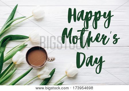 Happy Mothers Day Text Sign On Tulips And Coffee On White Wooden Rustic Background. Stylish Flat Lay