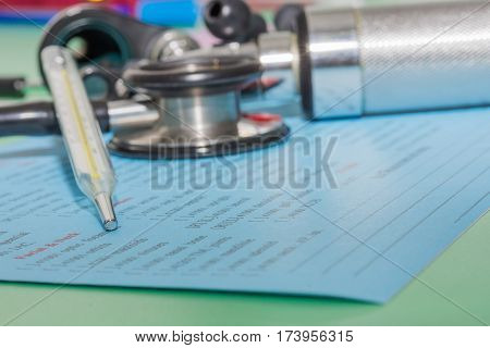 Thermometer Otoscope And Stethoscope On The Lap Sheet