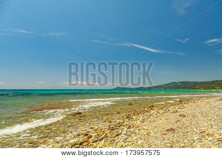The Rocky Coast  Overlooking The Turquoise Blue Sea In Warm Summer Day.