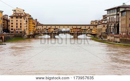 Florence Italy. River Arno and famous bridge Ponte Vecchio (Italian: Firenze Toscana).