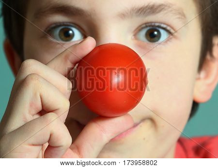 Teenager Boy With Tomato Red Nose